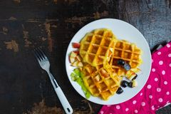 Delicious waffles in a plate on the table. royalty free stock images