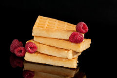 Delicious waffles with raspberries. Royalty Free Stock Photography