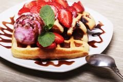 Delicious waffles with strawberry and ice cream Stock Photography