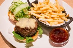 Delicious wagyu beef burger with french fried and sauce. stock photo