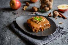 Walnut cake with grated apple layer and caramel toping royalty free stock image