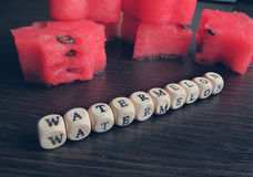 Delicious watermelon and a sign of beads Stock Image