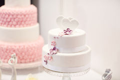 Delicious wedding cake in white , creme and pink Stock Images