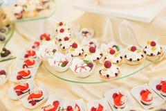 Delicious wedding reception candy bar dessert table Stock Photography