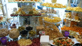 Delicious wedding reception candy bar dessert table stock video footage