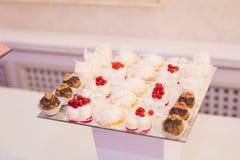 Delicious wedding reception candy bar dessert table Stock Photo