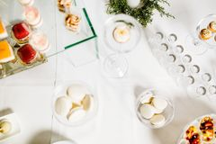 Wedding reception dessert table with delicious decorated white c stock images