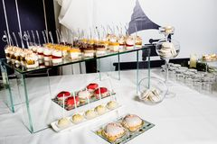 Wedding reception dessert table with delicious decorated white c stock photography