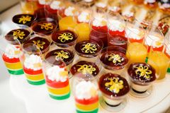 Delicious wedding reception candy bar dessert table. Delicious wedding reception candy bar dessert table Stock Image