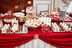Delicious wedding reception candy bar dessert table. Delicious wedding reception candy bar dessert table Stock Photography
