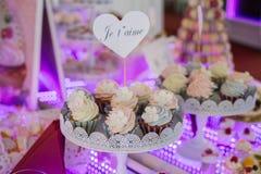 Delicious wedding reception candy bar dessert table. Stock Photos