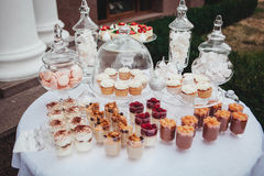 Delicious wedding reception candy bar dessert table. Swetts, cupcakes.  Stock Images