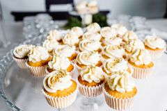 Wedding reception dessert table with delicious decorated white c royalty free stock image