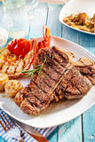 Delicious well done surf and turf steak and lobster meal Stock Image