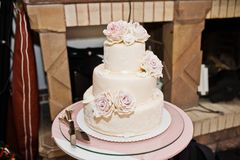 Delicious white and beige wedding cake decorated with flowers st Royalty Free Stock Photos