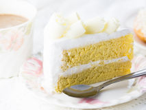 Free Delicious White Chocolate Cake On Beautiful Plate And A Cup Of Coffee On Wooden Table Stock Photo - 69600800
