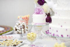 Delicious white decorated wedding cake royalty free stock photos