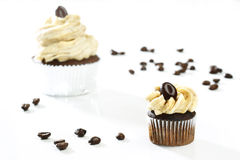 Delicious white vanilla cupcakes with coffee Stock Images