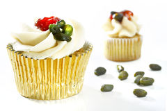 Delicious white vanilla cupcakes with green coffee beans Royalty Free Stock Photos