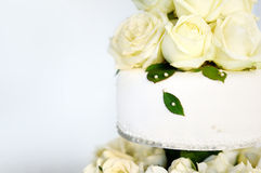 Delicious white wedding cake decorated with flowers Stock Photography