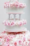 Delicious wedding cake decorated with roses Stock Photos