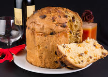 Delicious whole panettone with a slice. Stock Photo
