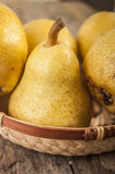 Delicious Williams or Bartlett pears. On a rustic wooden kitchen table Royalty Free Stock Image
