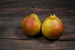 Delicious Williams pears on a rustic wooden table Royalty Free Stock Photography