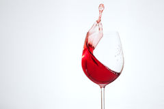 Delicious wine in a glass on a white background. The concept of. Beverages and alcohol Stock Photos