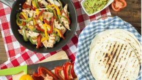 Delicious wrap tortilla with spicy chicken vegetables guacamole Royalty Free Stock Photos