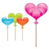 Delicious, wrapped heart-shaped lollipop collectio Royalty Free Stock Photos