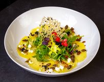 Delicious yellow beet carpaccio with goat cheese royalty free stock photography