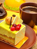 Delicious yellow cake with cranberries on ceramic sauc Stock Photos