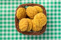 Delicious yellow cookie of corn on basket and green plaid table. Sweet food of Festa Junina, a typical brazilian party, holiday event in June Stock Photography