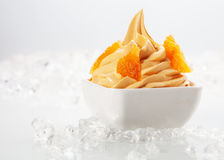 Delicious Yellow Frozen with Tasty Toppings Royalty Free Stock Photography