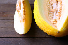 Delicious yellow melon on a wooden table Royalty Free Stock Image
