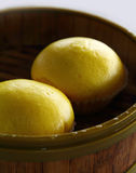 Delicious Yellow Oriental Custard Buns. On Wooden Tray Stock Images