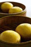 Delicious Yellow Oriental Custard Buns. On Wooden Tray Stock Photos