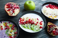 Delicious yoghurt smoothie bowls with assorted healthy fillings royalty free stock photography