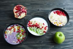 Delicious yoghurt smoothie bowls with assorted healthy fillings stock photography