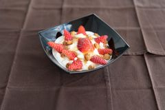 A bowl of yogurt, strawberries and honey. Delicious yogurt with fresh red strawberries and honey on the top royalty free stock images