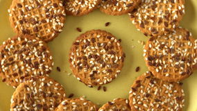Delicious yummy freshly baked homemade cookies rotating on a green bamboo plate. Looped. stock video footage