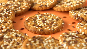 Delicious yummy freshly baked homemade cookies rotating on a orange bamboo plate. Looped. stock video