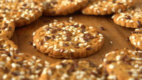Delicious yummy freshly baked homemade cookies rotating on a wooden board. Looped. stock video footage