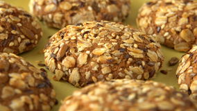 Delicious yummy freshly baked homemade oatmeal cookies rotating on a green bamboo plate. Looped. stock video footage