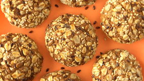 Delicious yummy freshly baked homemade oatmeal cookies rotating on a orange bamboo plate. Looped. stock video footage