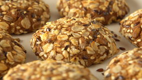 Delicious yummy freshly baked homemade oatmeal cookies rotating on a white bamboo plate. Looped. stock video footage