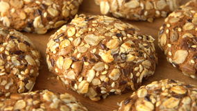 Delicious yummy freshly baked homemade oatmeal cookies rotating on a wooden board. Looped. stock footage