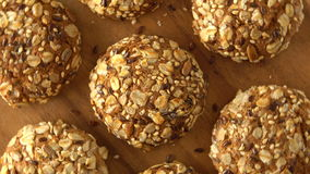 Delicious yummy freshly baked homemade oatmeal cookies rotating on a wooden board. Looped. stock video footage
