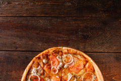Delicious yummy pizza on wooden table, flat lay Stock Photo